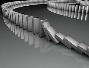 Eine Domino Reihe fällt